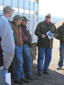Game Warden Neil Hymas (badge center) explains to volunteers how to conduct the mortality surveys.