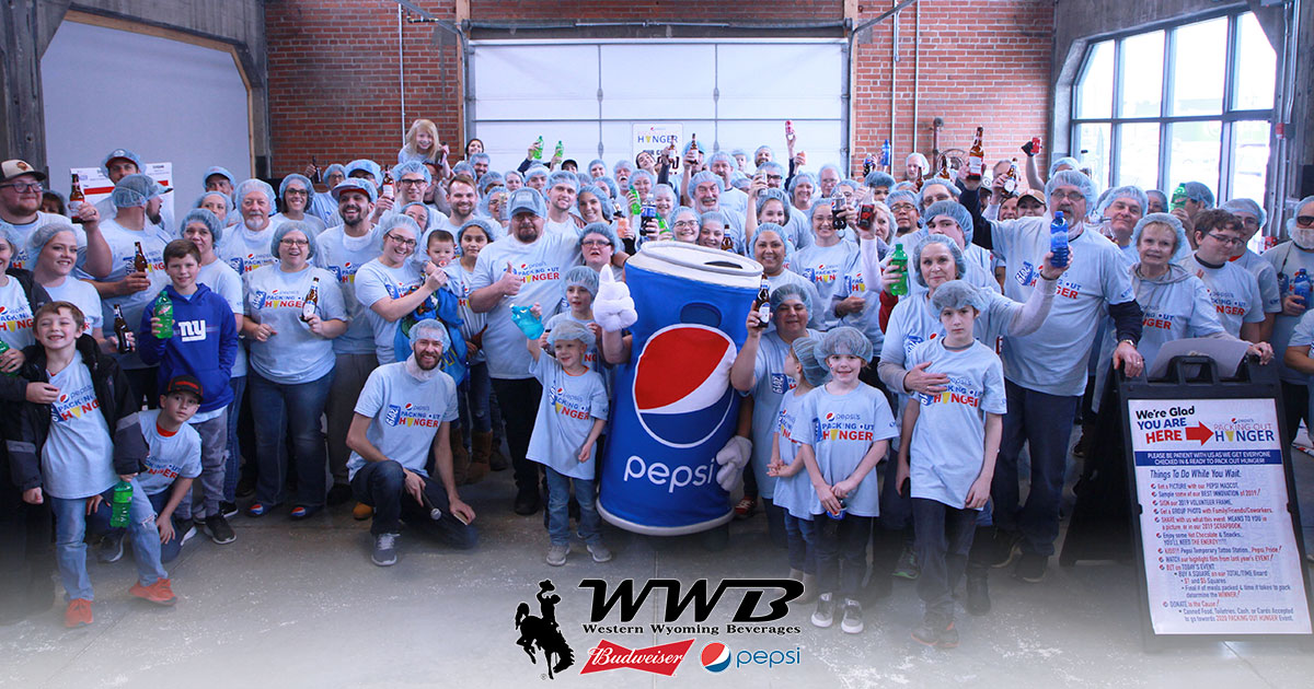 WWB Leads Packing of Over 55K Meals to be Donated to Local Food Banks