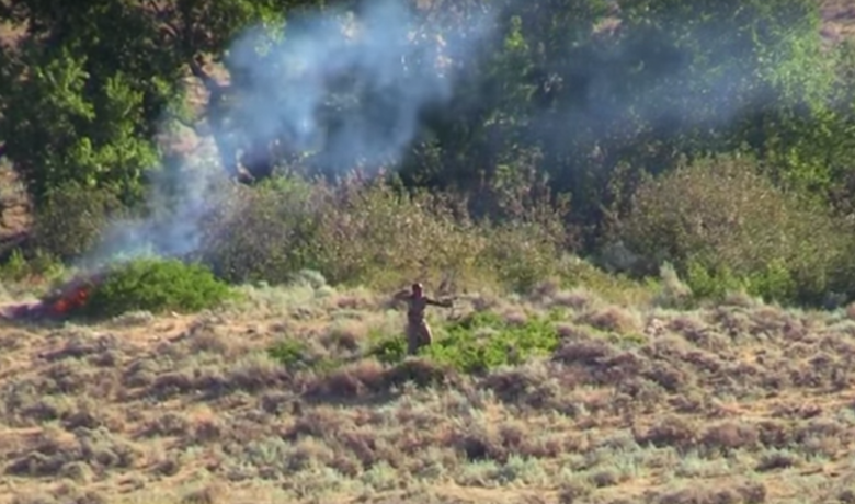 VIDEO: Sparks Ignite Fire After Hunter's Arrow Ricochets Off Rock
