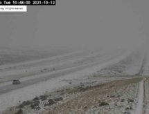 PHOTOS: First Storm of Season Brings Road Closures, Travel Warnings